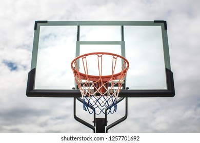 Basketball and the sky are full of clouds.
