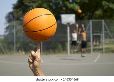 Basketball Spinning with blurred players in the background