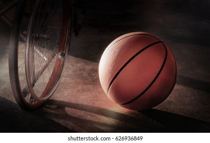 Basketball and Wheel chair in a lonely atmosphere, in concept Disappointment, injury, discouragement, despair