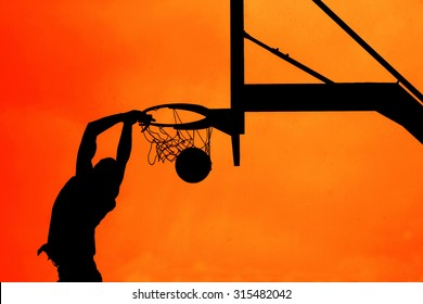 Basketball:silhouette of a dunking man