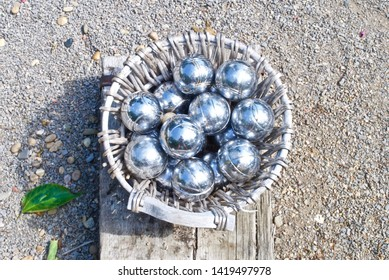 A basketful of boules on a sunny day