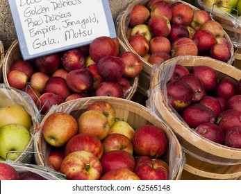 Baskets of apples on display with sign at the local farmers outdoor maket