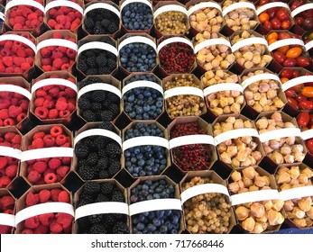 baskets of berries at jean talon market, montreal, quebec, canada
