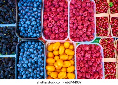 Baskets of berries in a market. mixed berries. bio colorful berries