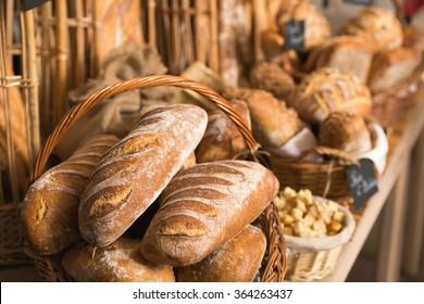baskets of bread on a shelf, in a bakery store