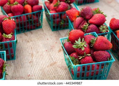 Baskets of Fresh Organic Strawberries at a Farmer's Market
