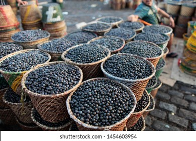 Baskets full of fresh acai fruits coming from the deep amazon forest are seen for sell at Ver O Peso public market in Belem do Para, north of Brazil.