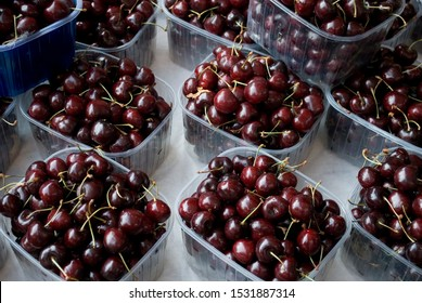 baskets full of red and ripe cherries, on sale at local vegetable market, food, fruit, summer, Milan, Italy
