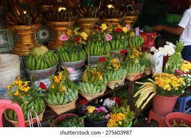 Baskets of green bananas and coconuts for donation in  Botataung Pagoda, Yangon,  Myanmar (Burma)
