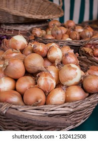 A baskets of onions at farmers market in Paris (France)