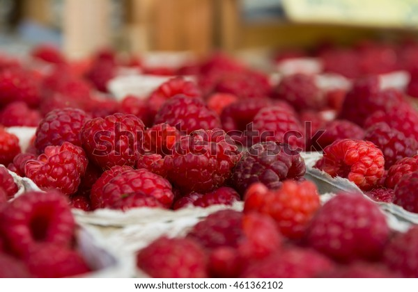 Baskets of Raspberries Macro at Local Food Market