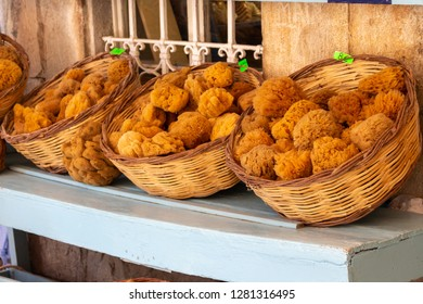 Baskets of sponges in a souvenir shop in Symi, an island in Greece near Rhodes