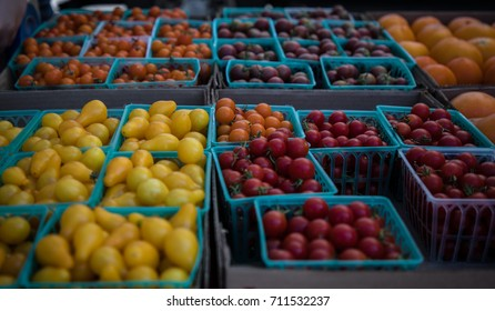 Baskets of tomatoes and fruit at a farmer's market