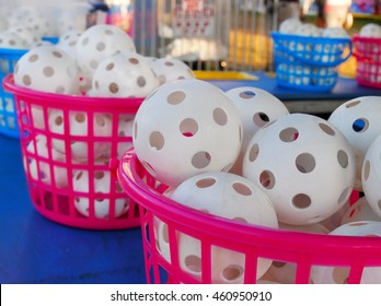 Baskets of wiffle balls at a carnival game, with copy space.