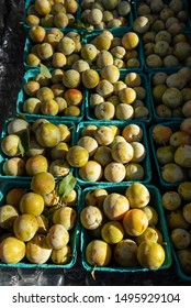 baskets of yellow fruit at farmers market