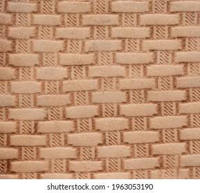 Basketweave pattern on vegetable tanned leather closeup macro