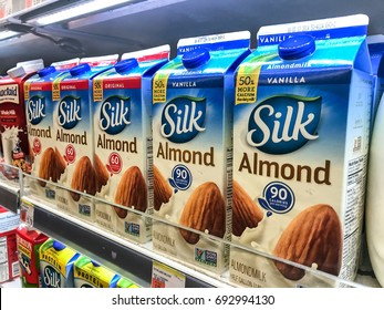 Basking Ridge, NJ, August 6, 2017: Cartons of almond milk stand on a shelf in a supermarket.