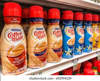 Basking Ridge, NJ, August 6, 2017:  Nestle Coffee-mate bottles stand on a shelf of a supermarket.