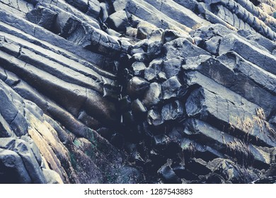 Baslalt colums in Iceland. Texture, patterns, natural phenomenon, nature, landscape concepts.