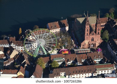 Basle, Cathedral with ferris wheel at the Herbstmesse