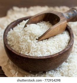 Basmati rice in a bowl with a spoon close up