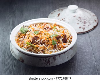 Basmati rice cooked with masala filled with  muttton