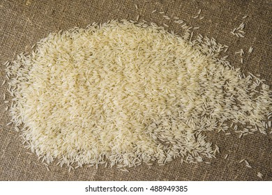 basmati rice linen background space for text . White basmati rice linen fabric .