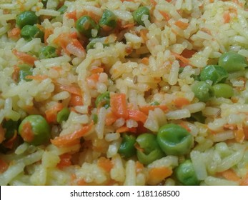 Basmati Rice Pulao or pulav with Peas, or vegetable rice using green peas also known as matar pulao with black background