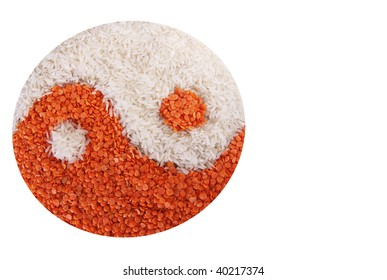 Basmati rice and red lentils in the shape of the yin-yang symbol.