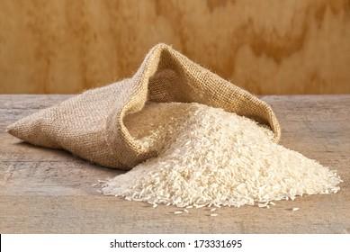 Basmati Rice Spilling from Sack - basmati rice spilling from burlap or jute sack.