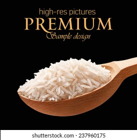 Basmati rice in a wooden spoon / cereal on wooden spoons isolated on black background with place for your text