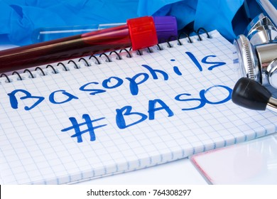 Basophils count procedure (#Baso) white blood cell test. Laboratory test tubes with blood, stethoscope, smear or film and gloves are near note with text Basophils (#Baso) on table in doctor office
