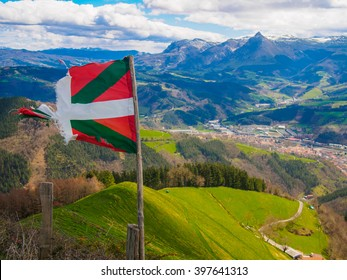 Basque country flag Txindoki mountain on sunny day