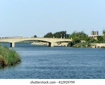 BASRA, IRAQ - CIRCA MAY 2007: Sadaam-era pedestrian bridge over the Shatt al-Arab