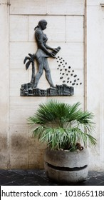 a bas-releif of a woman sowing coffe beans on the walls of  La Casa Del Caffe near the Piazza della Rotonda near the Pantheon