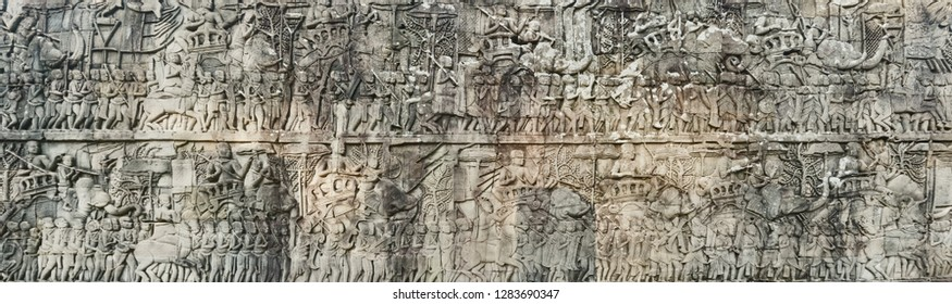 Bas-relief at Bayon temple in Angkor Thom at morning time. Siem Reap. Cambodia. Panorama