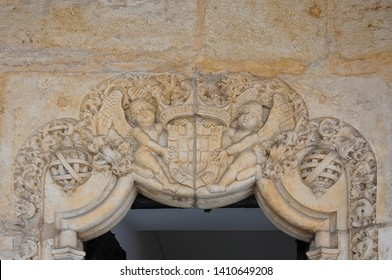 Bas-relief with the coat of arms of Portugal on the lintel of a door in the Jerónimos Monastery of Lisbon, Portugal