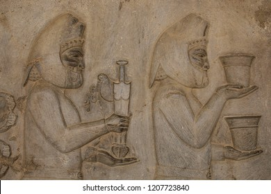 Bas-relief  depicts ambassadors, bearing gifts to the king. Ancient relief on the wall of the ruined city of Persepolis. Ancient Persia. Iran.