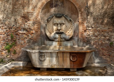 Bas-relief with drinking fountain in Rome, Italy