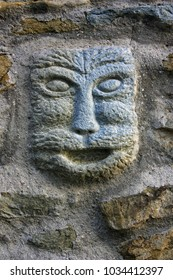 Bas-relief - the head of a cat