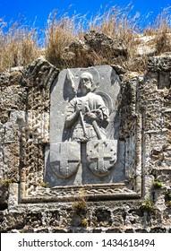 Bas-relief, heraldry, image of knight, crusaders, order of St. John of Jerusalem