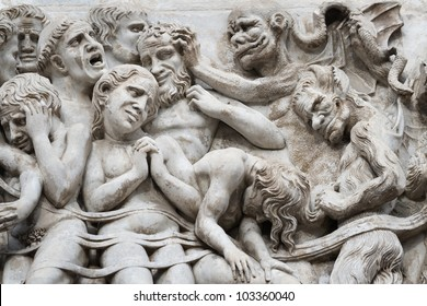 Bas-relief with the Last Judgement image on a facade of the Cathedral  Duomo in the city of Orvieto, Umbrija, Italy