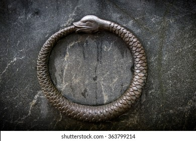 Bas-relief of ouroboros, a snake biting its own tail