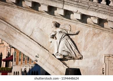 Bas-relief of women on the Rialto Bridge, Venice