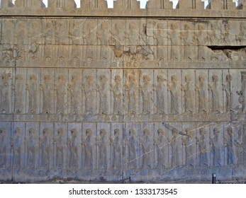 Bas-reliefs of marching Midian and Persian warriors decorating walls of Apadana palace in Persepolis, ex capitol of Persia. This open air museum is located near Shiraz, Islamic Republic of Iran