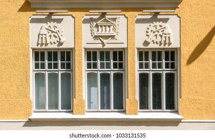 Bas-reliefs on facade of yellow house, Kuopio, Northern Savonia, Finland