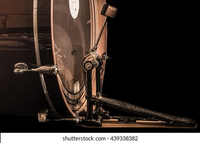bass drum with pedal, musical instrument on black background