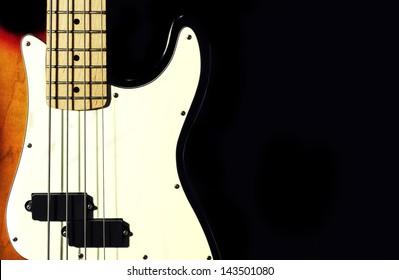 bass guitar. black background.close-up.musical instrument
