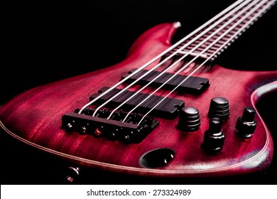 Bass guitar body view (low key, shallow depth of field)