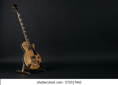Bass guitar isolated on black background with copy space.